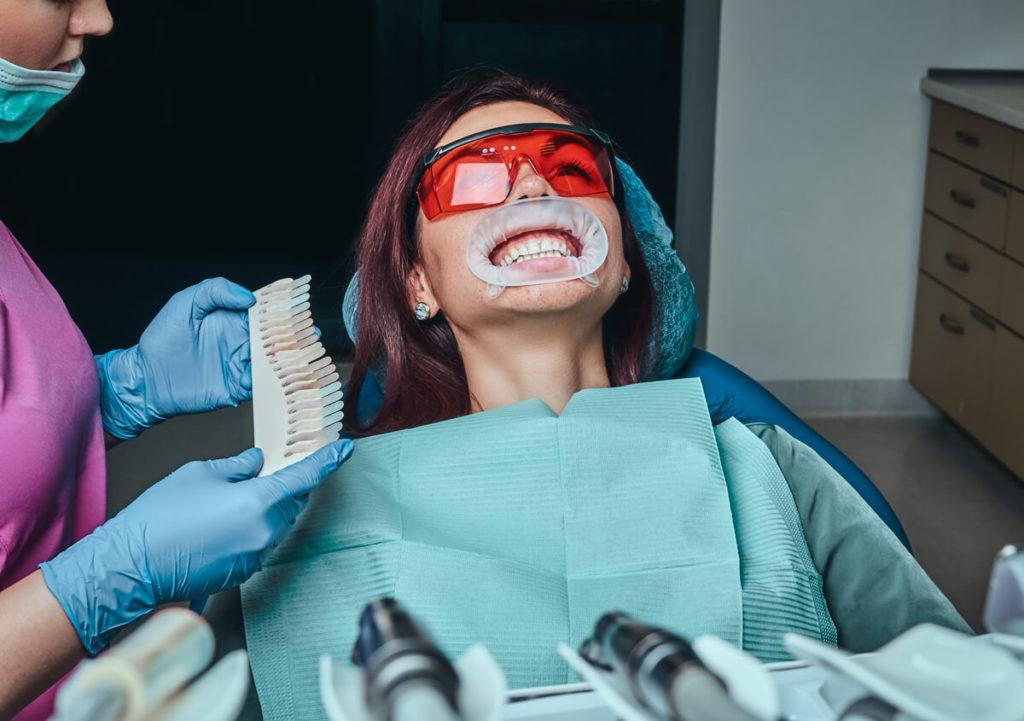 a woman dentist checks the level of teeth whitenin 78USUV9 1 - Ventura Dentist | Cidentist Dentist